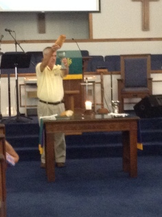 Pastor Bill Pollack leading Holy Communion